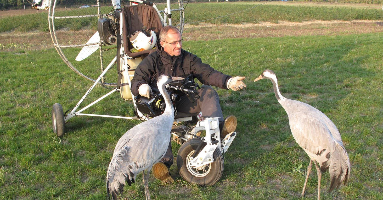 Microlight expert GTC member Richard Cook, who was awarded a GTC Award for his work on Earthflight, makes friends with t