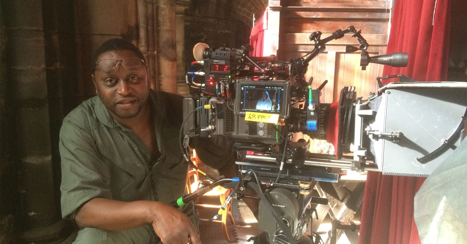 GTC member DoP Andrei Austin lining up a shot on 'Outlander' in Glasgow Cathedral with Panavised ARRI Amira